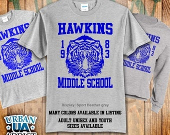 Hawkins Middle School T-shirts. Sizes: Unisex Adult and Youth. Professional Screen Print. Inspired by the TV series Stranger Things.