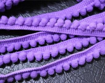 2 meters of 6mm purple colored tassel trim