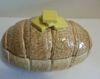 Ceramic Loaf of Bread Dish With Butter on Top