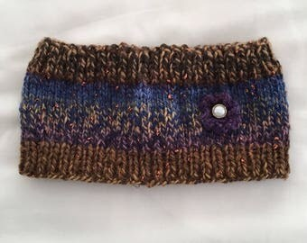 Hand knitted headwarmer with flower