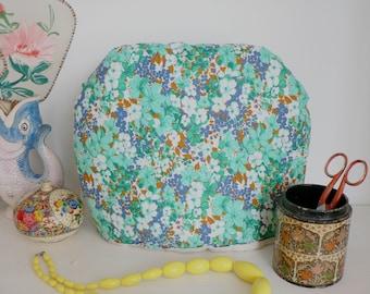 Vintage retro floral tea-cosy
