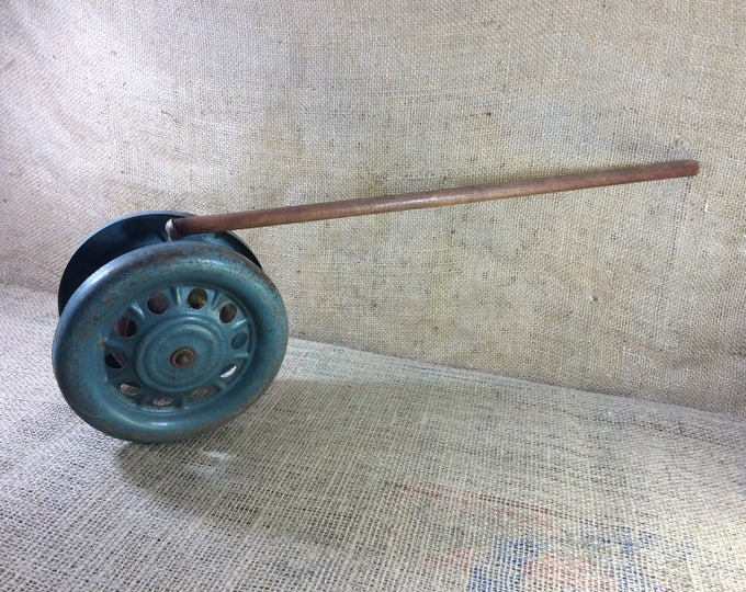 Vintage metal push toy for toddlers, noisemaker push toy with wheels, antique push toy from the mid century, vintage toy decor