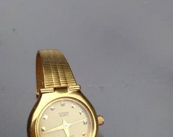 Vintage Citzen twist watch gold plated gold bracelet watch perfect working condition with security chain