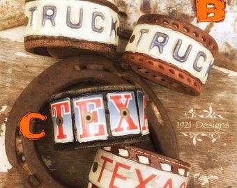 Hand cut Texas license plate leather belt cuffs