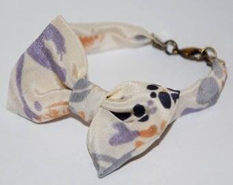 Bracelet knot 86 beige/purple/violet/flesh pattern stain