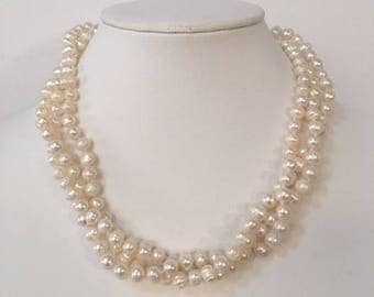 Triple strands of creamy white fresh water pearls.