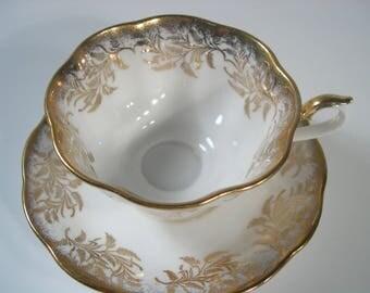 Royal Albert Tea Cup and Saucer, White and Gold teacup and saucer set.