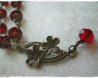 Bronze flower and crystal pendant