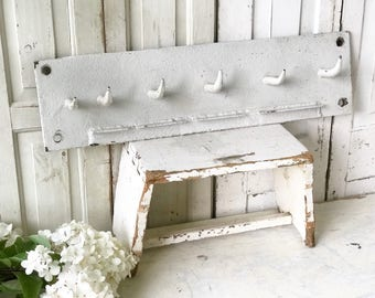 An antique French Butchers hooks rack coat pegs