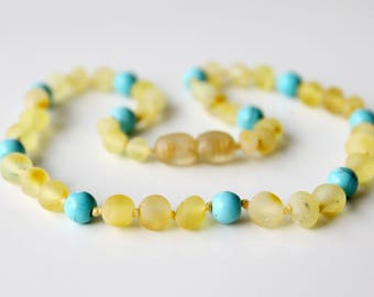 Authentic raw baltic amber baby teething necklace. 32 cm/12.6 in Amber necklace with turquoise beads.