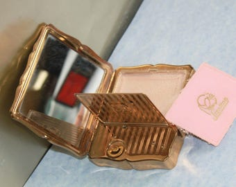 Musica Stratton of  England Musical Compact Mirror which plays Brahms Waltz  c1950's Rare and Hard To Find. In original box with pouch.