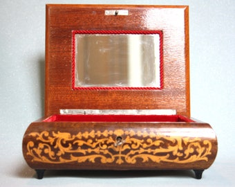 A beautiful Reuge, musical jewellery box. Decorative inlaid wood, with a swiss movement that plays Torna a Surriento.