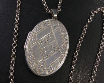 Silver oval locket on chain