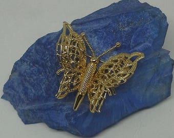 Vintage Monet Gold tone filigree pin/brooch butterfly design