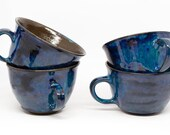 4 ceramic mugs with small saucers