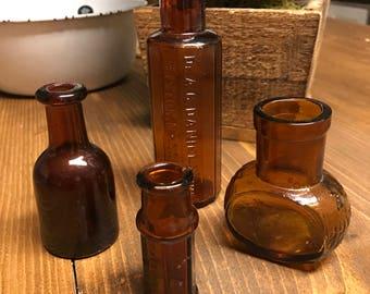 Sale* Set of four, vintage bottles, medicine bottles, amber bottles, brown bottles, bovil, Dr. A.C. Daniels, sharp & dohme