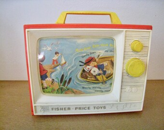 Fisher Price Two Tune Television Music Box. 1966 vintage toy. works. Plays London Bridge and Row Row Row Your Boat.