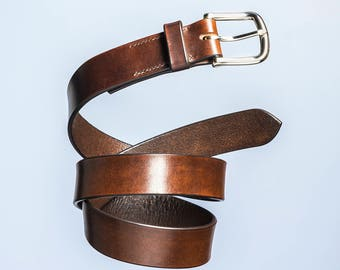 Vegetable tanned leather belt with solid brass buckles. 1 1/4 inch / brown / nickle plate heel bar buckle