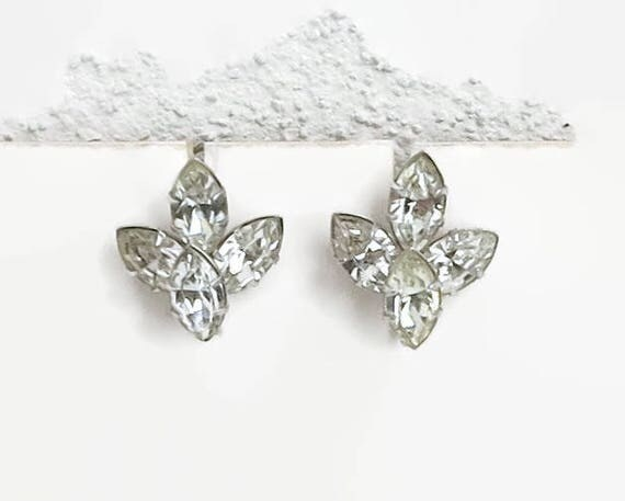 Mid century crystal earrings with 4 large oblong clear crystals in cup and prong settings, shaped like part of a flower, screw backs, 1950s