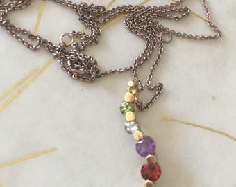 Lovely Sterling Silver with Gold Over Garnet, Amethyst, Peridot and Blue Topaz Necklace.Chain 16-20 inches long.