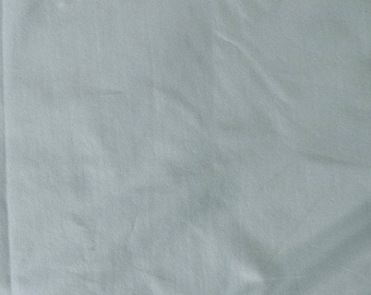 Fabric - cotton/elastane t-shirt weight jersey fabric -  dusky mint - knit fabric.