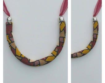 """Safari"" crochet bead necklace."