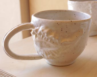 Hand built stoneware white mug with pressed molding: Artifact series