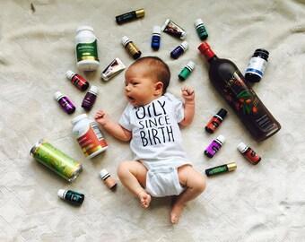 Oily Since Birth onesie