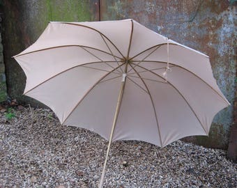 Pale Peach French Umbrella, matching sleeve. Gold metal stem, faux wood curved detachable handle. Vintage sun parasol. NylFrance antique.