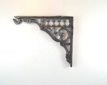 A lovely antique style cast iron wall light hanging bracket hook shelf shelving bracket