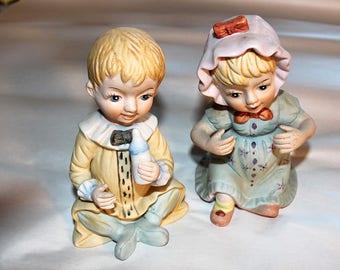 Glass baby figurines