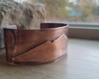 Copper cuff, mountain and moon