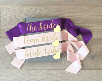 The bride sash, team bride sash, bride tribe sash, bachelorette sash with gold heart pin, hen sash, hen party sash, bridal sash