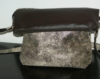 /Pochette spotted brown and plain leatherette bag.