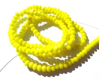 30 ROUND GLASS BEADS HAS FACETED YELLOW 3MM
