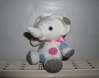 little white elephant crochet with its colorful patches
