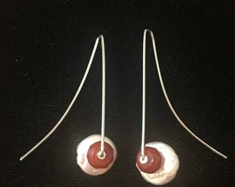 Swish dangle wire earrings with freshwater pearls and red carnelian