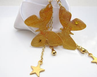 Gold butterfly earrings and its magic