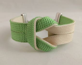 Green and off-white knot bracelet created with a vintage, silk kumihimo obijime tie