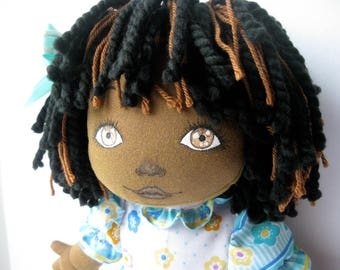 Black cloth doll 19 inches with removable clothing.