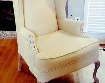 Natural Linen Wingback Chair with Raw Nailhead Accents