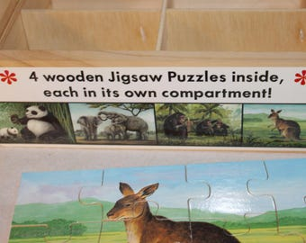 Jigsaw in a Box, Four Puzzles included in the Box, Look at pictures, 48 Wood Pieces, Complete Puzzles, Box has Sections for Each Puzzle