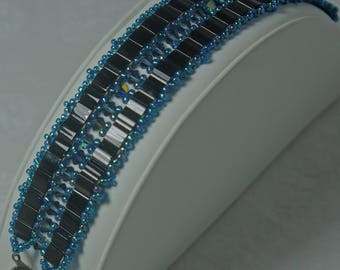 Blue and black crystal glass cuff style bracelet