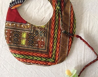 Bib with pacifier dashiki pattern