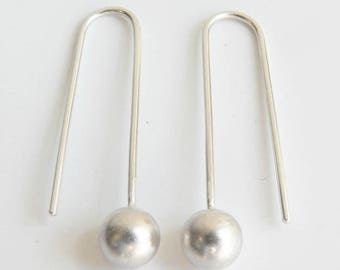 Silver earrings with balls, long