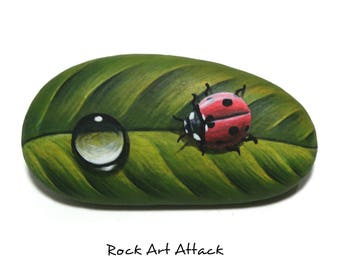 Red ladybug and waterdrop on green leaf hand painted pebble magnet! Original acrylic painting on natural smooth pebble by Rock Art Attack.