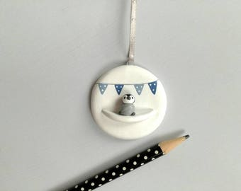Miniature penguin chick and blue bunting. Little pottery penguin hanger. Hand painted ceramics, new baby boy