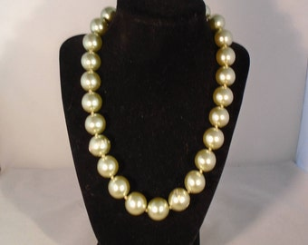 """Joan Rivers Classics Collection 19"""" Necklace with a 3"""" Extender. The Necklace has a Pearly Lucite Pale Shade of Green Faux Pearls."""