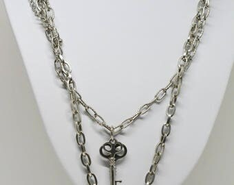 Silver tone necklace with lock and key charms