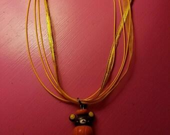 Rilakkuma dressed in pumpkin necklace